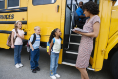 children fall in line to get in the bus