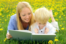 Woman teach the boy how to read